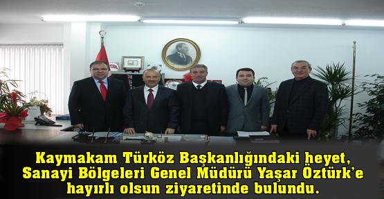 Kaymakam Türköz Başkanlığındaki heyet, Sanayi Bölgeleri Genel Müdürü Yaşar Öztürk'e hayırlı olsun ziyaretinde bulundu.
